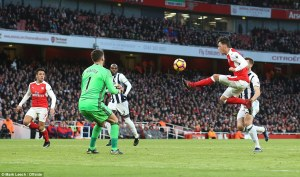 3ba6657600000578-4066602-mesut_ozil_leaps_to_try_and_get_hold_of_the_ball_as_foster_close-a-11_1482774129281