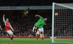 3ba6cf0900000578-4066602-aaron_ramsey_reacts_after_giroud_loops_the_ball_over_ben_foster_-a-224_1482771134467
