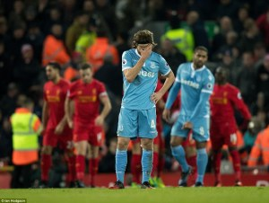3bab895000000578-4068990-stoke_city_s_players_are_left_dejected_by_liverpool_s_fourth_goa-a-15_1482922723784