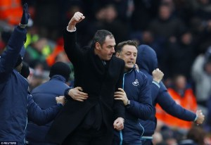3c5aa18c00000578-4142872-swansea_city_manager_clement_celebrates_on_the_anfield_touchline-a-17_1485011811782